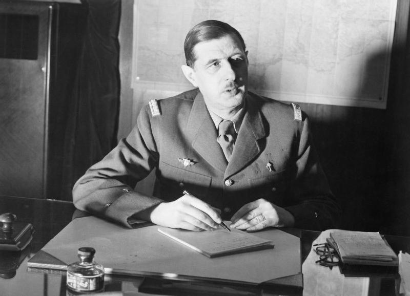 Commander of Free French Forces General Charles de Gaulle seated at his desk in London during the Second World War. D1973